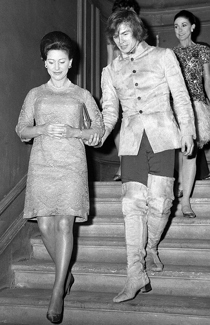<p>Ballet dancer Rudolf Nureyev accompanies Princess Margaret down the stairs of the Royal Academy of Dancing in Knightsbridge in 1968.</p>