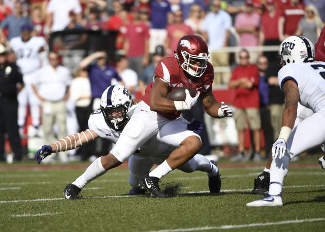 """Arkansas running back <a class=""""link rapid-noclick-resp"""" href=""""/ncaaf/players/266565/"""" data-ylk=""""slk:Devwah Whaley"""">Devwah Whaley</a> is tackled by TCU defender <a class=""""link rapid-noclick-resp"""" href=""""/ncaaf/players/225939/"""" data-ylk=""""slk:Mat Boesen"""">Mat Boesen</a> just short of the goal line in the second half of an NCAA college football game in Fayetteville, Ark., Saturday, Sept. 9 2017. AP Photo/Michael Woods)"""