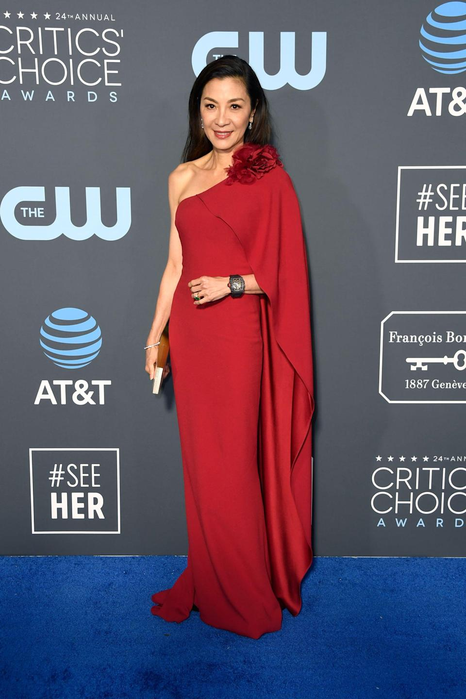 <p>Michelle Yeoh wearing a red one-shoulder gown.</p>