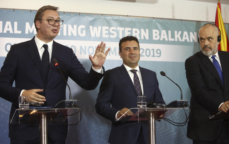 Serbia's President Aleksandar Vucic, left, talks next to North Macedonia's Prime Minister Zoran Zaev, center and Albania's Prime Minister Edi Rama, right, during a joint news conference, following the Western Balkan leaders' meeting in the southwestern town of Ohrid, North Macedonia, Sunday, Nov. 10, 2019. Western Balkan leaders say they are committed to work closely and to remove administrative barriers for free movement of goods and people between their countries. (AP Photo/Boris Grdanoski)