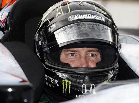 IndyCar Series driver Kurt Busch sits in his car during practice for the day for the 2014 Indianapolis 500 at Indianapolis Motor Speedway. Mandatory Credit: Brian Spurlock-USA TODAY Sports