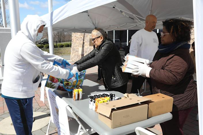 Department of Education employees give lunch and breakfast to residents in Paterson, New Jersey, in March 2020.