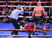 Both fighters were knocked down on multiple occasions in an enthralling contest full of improbable twists and turns (AFP/Robyn Beck)