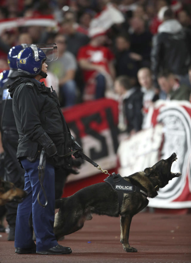 <p>Police with dogs keep watch over FC Koln fans during the Europa League match against Arsenal at the Emirates Stadium, London, Thursday Sept. 14, 2017. (Photo: Nick Potts/PA via AP) </p>