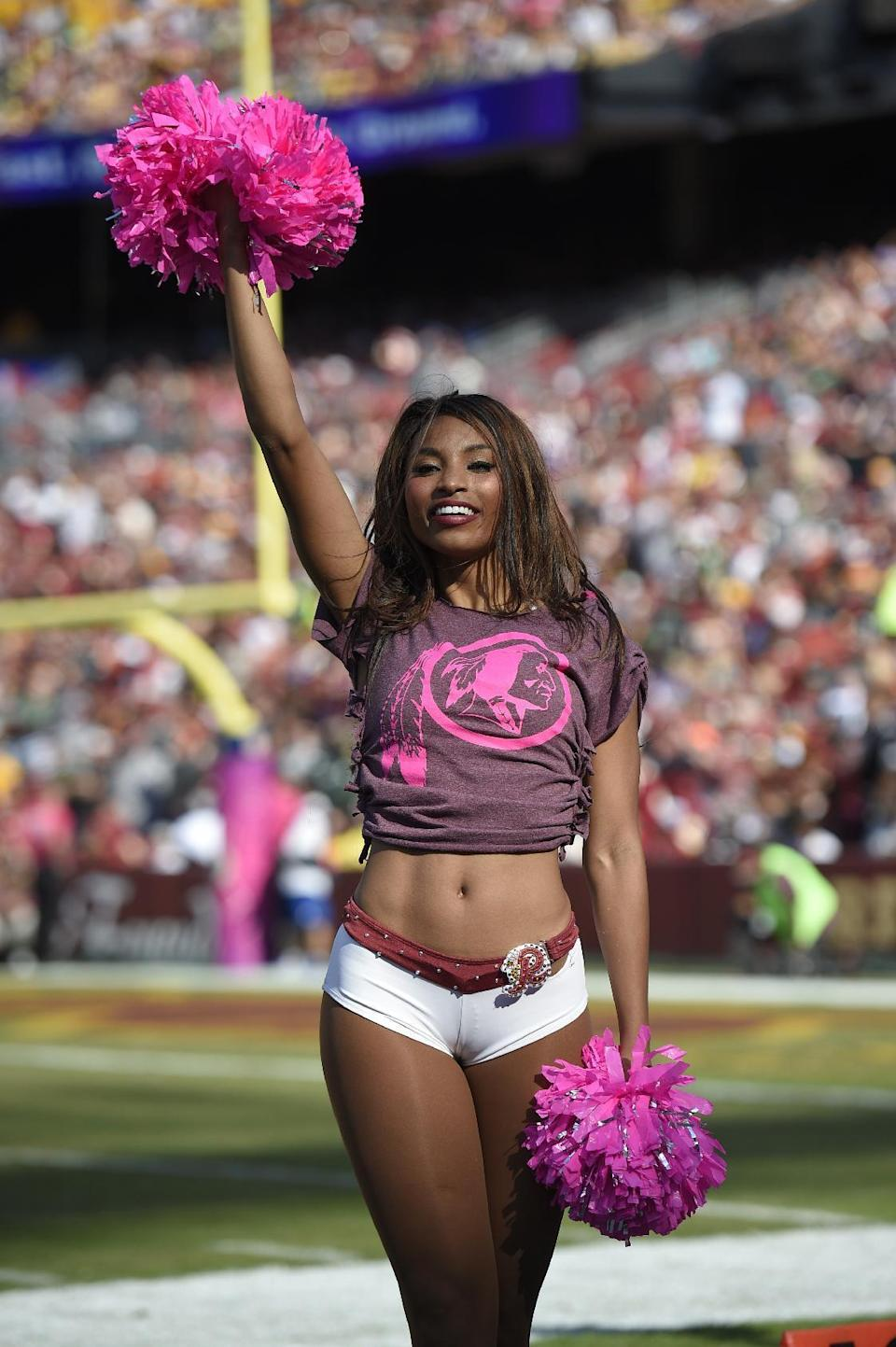 <p>A Washington Redskins cheerleader performs during an NFL football game between the Redskins and the Philadelphia Eagles, Sunday, Oct. 16, 2016, in Landover, Md. (AP Photo/Nick Wass) </p>