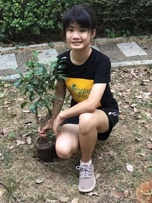 Howey Ou uses her pocket money to buy trees to plant in her hometown. Photo: Handout