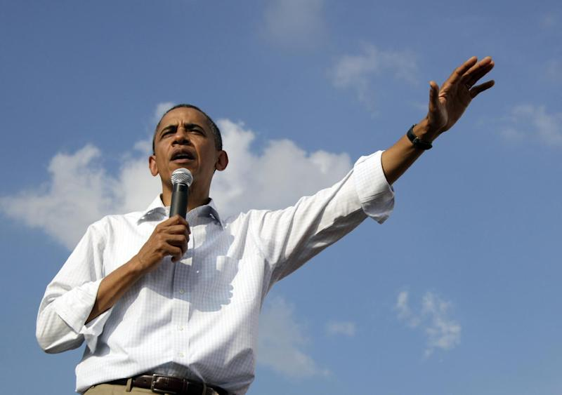 President Barack Obama speaks during a town hall meeting, Wednesday, Aug. 17, 2011, at Country Corner Farm Market in Alpha, Ill., during his three-day economic bus tour.  (AP Photo/Carolyn Kaster)
