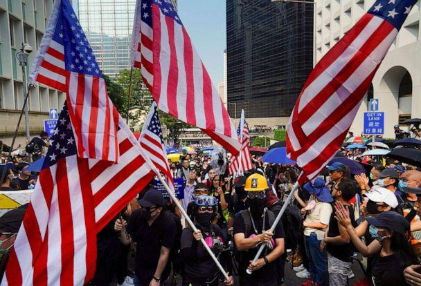 PHOTO: Protesters shout slogans and wave U.S. flags as they march from Chater Garden to the U.S. Consulate in Hong Kong, Sunday, Sept. 8, 2019. (Vincent Yu/AP, FILE)