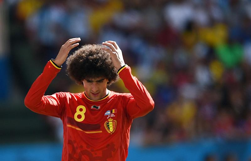 Belgium's midfielder Marouane Fellaini reacts after missing a goal opportunity during a quarter-final football match between Argentina and Belgium at the Mane Garrincha National Stadium in Brasilia during the 2014 FIFA World Cup on July 5, 2014
