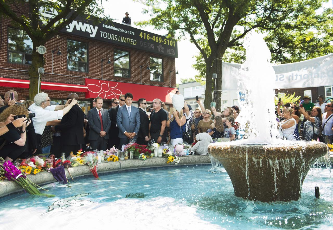 <p>Prime Minister Justin Trudeau pays his respects at the fountain at the Alexander the Great Parkette, near where people were gunned down and injured from the recent Danforth shootings in Toronto on Monday, July 30, 2018. Photo from The Canadian Press. </p>