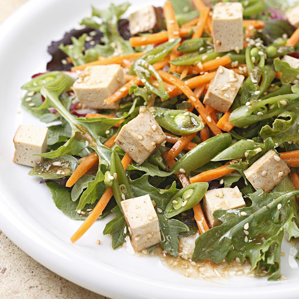<p>This Asian-inspired salad is made satisfying with savory baked tofu; carrots and snap peas add crunch. Try this salad for a take-along lunch. To keep the salad greens from getting soggy, pack the greens, salad toppings and dressing in separate containers and toss them together just before eating.</p>