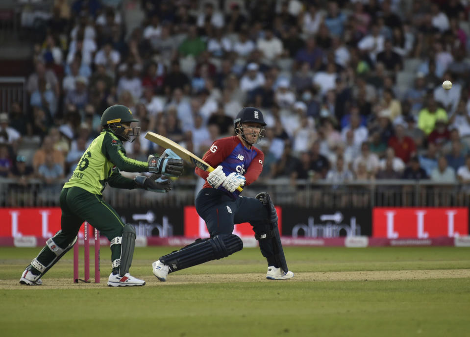 England's Jason Roy, right, plays a shot during the third Twenty20 international cricket match between England and Pakistan at Old Trafford in Manchester, Tuesday, July 20, 2021. (AP Photo/Rui Vieira)