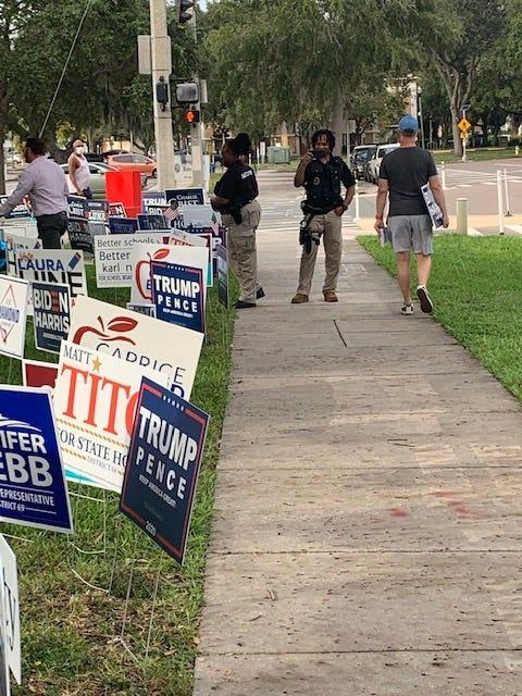 Voters say armed guards stood near an early voting site in St. Petersburg, Fla., on Oct. 21, 2020.