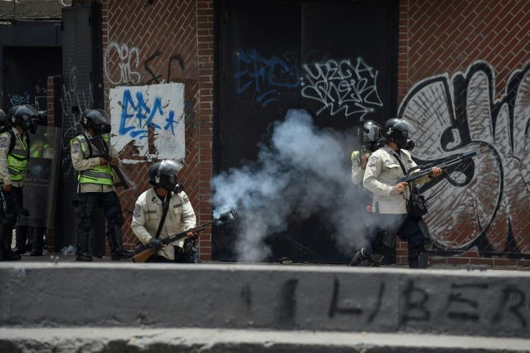 Riot police had deployed in force ahead of Wednesday's mass demonstrations in Caracas