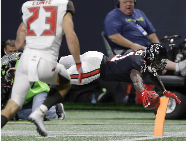 <p>Atlanta Falcons wide receiver Julio Jones (11) scores a touch down against the Tampa Bay Buccaneers during the first half of an NFL football game, Sunday, Nov. 26, 2017, in Atlanta. (AP Photo/Chris O'Meara) </p>