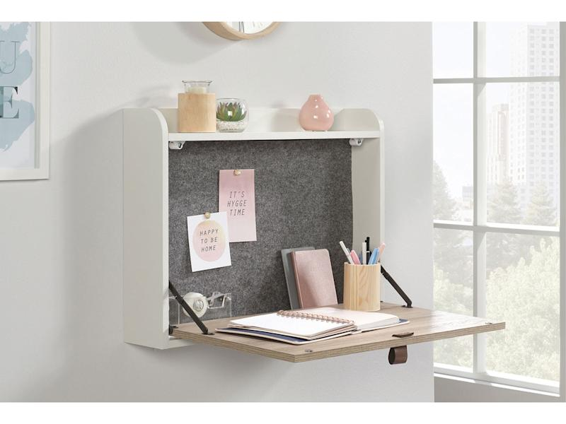 This sturdy structure has space for hanging notes up tooFurniture Work