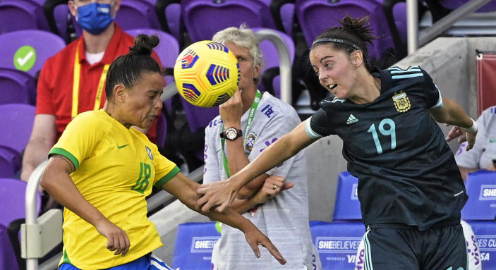 Brazil defender Camila (18) and Argentina forward Mariana Larroquette (19) battle for a header during the second half of a SheBelieves Cup women's soccer match, Thursday, Feb. 18, 2021, in Orlando, Fla. (AP Photo/Phelan M. Ebenhack)