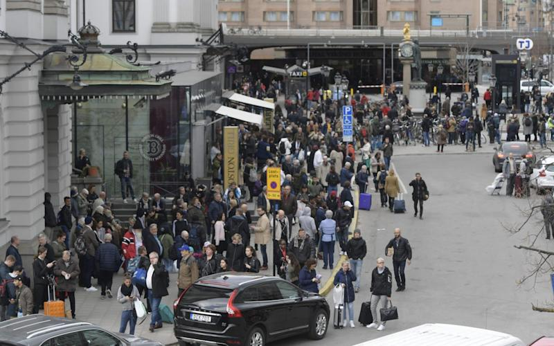 Police evacuate Stockholm's central station - Credit: Anders Wiklund /AFP