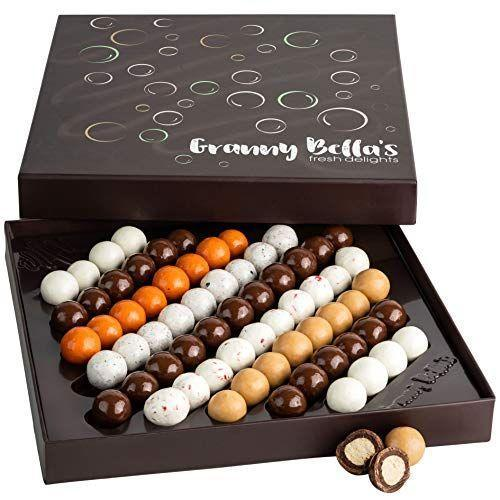"""<p><strong>GRANNY BELLA'S FRESH DELIGHTS</strong></p><p>amazon.com</p><p><strong>$29.99</strong></p><p><a href=""""https://www.amazon.com/dp/B08LKFF78R?tag=syn-yahoo-20&ascsubtag=%5Bartid%7C1782.g.994%5Bsrc%7Cyahoo-us"""" rel=""""nofollow noopener"""" target=""""_blank"""" data-ylk=""""slk:BUY NOW"""" class=""""link rapid-noclick-resp"""">BUY NOW</a></p><p>Creamy and crunchy, these malt balls are the perfect bite.</p>"""