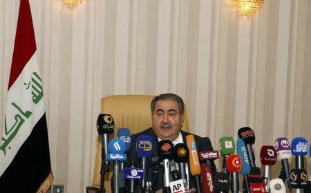 Iraq's Finance Minister Hoshiyar Zebari speaks during a news conference in Baghdad