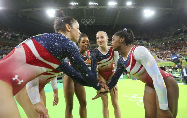 2016 Rio Olympics - Artistic Gymnastics - Final - Women's Team Final - Rio Olympic Arena - Rio de Janeiro, Brazil - 09/08/2016. Alexandra Raisman (USA) of USA (Aly Raisman), Gabrielle Douglas (USA) of USA (Gabby Douglas), Simone Biles (USA) of USA, Madison Kocian (USA) of USA and Laurie Hernandez (USA) of USA celebrate winning gold in the women's team final. REUTERS/Mike Blake FOR EDITORIAL USE ONLY. NOT FOR SALE FOR MARKETING OR ADVERTISING CAMPAIGNS.