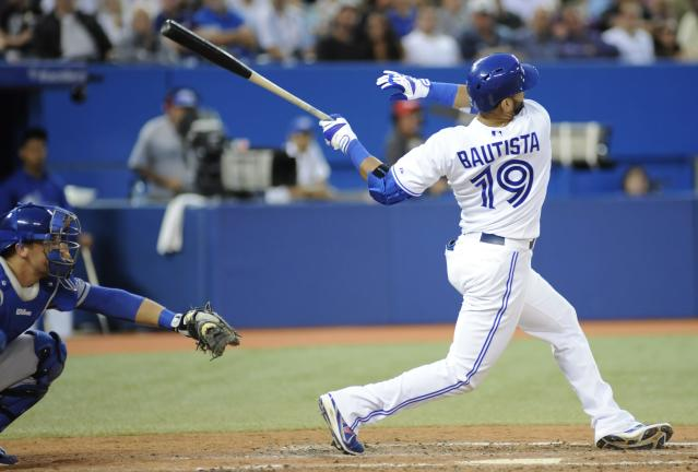 Toronto Blue Jays' Jose Bautista hits a solo home run against the Los Angeles Dodgers during the sixth inning of a baseball game Tuesday, July 23, 2013, in Toronto. (AP Photo/The Canadian Press, Jon Blacker)
