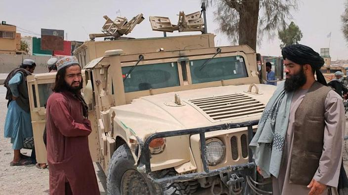 Taliban with captured vehicle