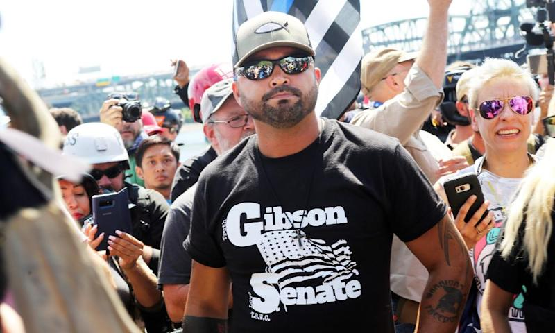 Joey Gibson stands with far-right demonstrators in Portland, last year.