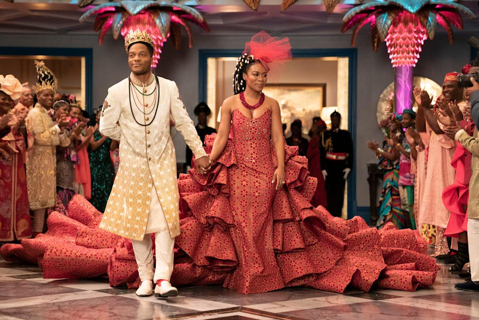 Nomzano Mbatha (R) couldn't pull the massive train of the wedding dress up the aisle without assistance. Eventually a wire set-up was created to keep the dress from knocking Jermaine Fowler (L) out of the camera frame.