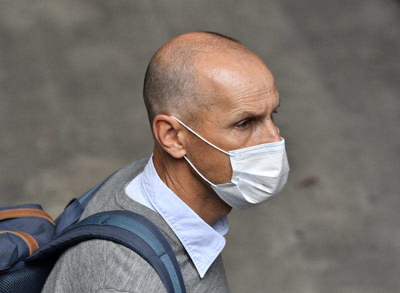 Augsburg's head coach Heiko Herrlich wearing a mask against the spread of the new coronavirus arrives prior to the German Bundesliga soccer match between FC Schalke 04 and FC Augsburg at the Veltins-Arena in Gelsenkirchen, Germany, Sunday, May 24, 2020. The German Bundesliga becomes the world's first major soccer league to resume after a two-month suspension because of the coronavirus pandemic. (AP Photo/Martin Meissner, Pool)
