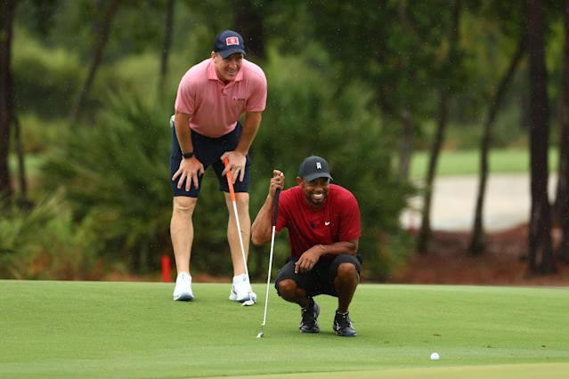 Tiger Woods and former NFL player Peyton Manning read a putt on the sixth green during The Match: Champions For Charity at Medalist Golf Club on May 24, 2020 in Hobe Sound, Florida. (Mike Ehrmann/Getty Images for The Match)