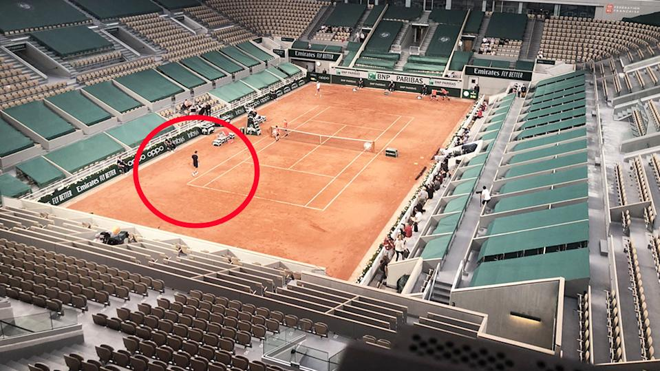 Daniil Medvedev and Stefanos Tsitsipas, pictured here playing their French Open quarter-final in an empty stadium.