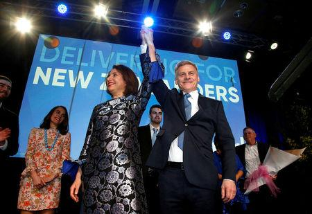FILE PHOTO - New Zealand Prime Minister Bill English and his wife Mary react on stage alongside family members during an election night event in Auckland, New Zealand, September 23, 2017.   REUTERS/Nigel Marple/File photo