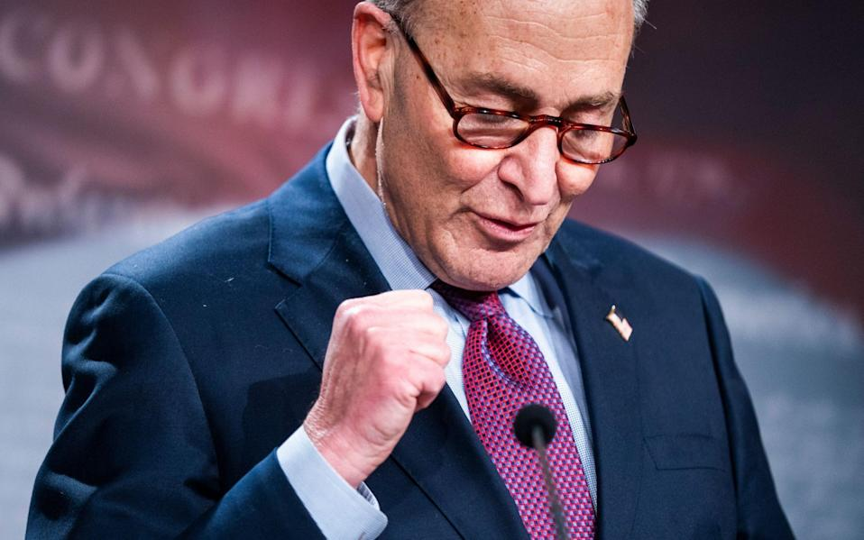 Senate Majority Leader Chuck Schumer celebrates the deal