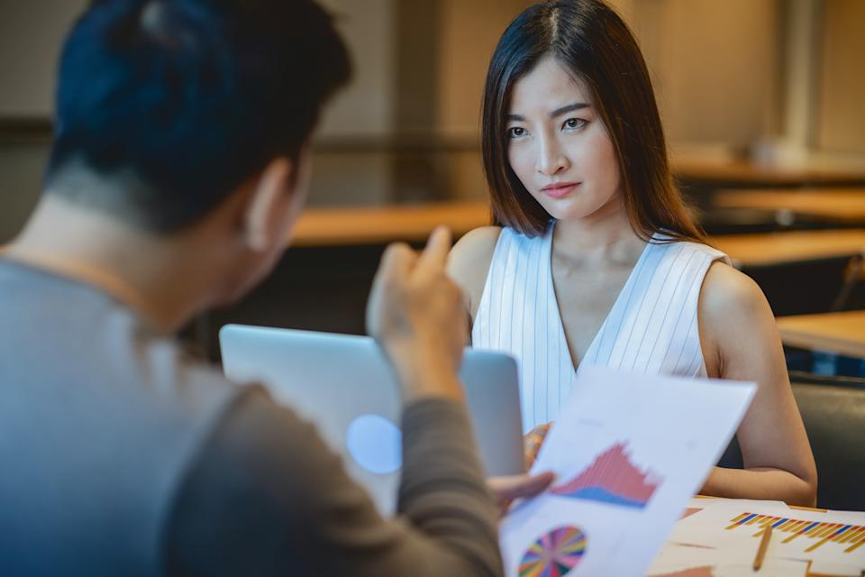 Business mistake and punish concept, Reaw view of Furious boss scolding asian young businesswoman in casual suit by point to her face about performance and KPI in modern office