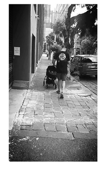 Tessa posted this adorable photo of husband Nate pushing their newborn in a stroller. Source: Instagram/tessacharis