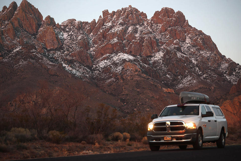 In this Thursday, March 4, 2020, photograph, a motorist carries a canoe on the roof his pickup truck while leaving the Organ Mountains Desert Peaks National Monument near Las Cruces, N.M. With events cancelled by the new coronavirus, people have turned to the great outdoors for entertainment as well as exercise in these turbulent times. The new coronavirus causes mild or moderate symptoms for most people. but for some, especially older adults and people with existing health problems, it can cause more severe illness or death. (AP Photo/David Zalubowski)