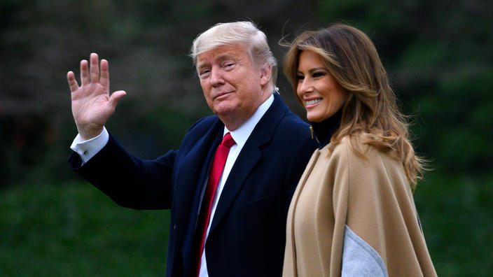 President Donald Trump waves next to First Lady Melania Trump as they walk to Marine One before departing from the South Lawn of the White House in Washington, DC on January 31, 2020. (Anrew Caballero-Reynolds/AFP via Getty Images)