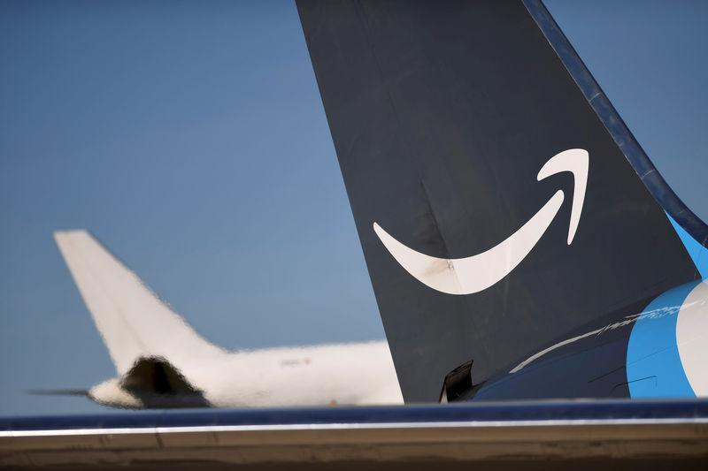 FILE PHOTO - A wide body aircraft emblazoned with Amazon's Prime logo is unloaded at Lehigh Valley International Airport in Allentown, Pennsylvania, U.S.
