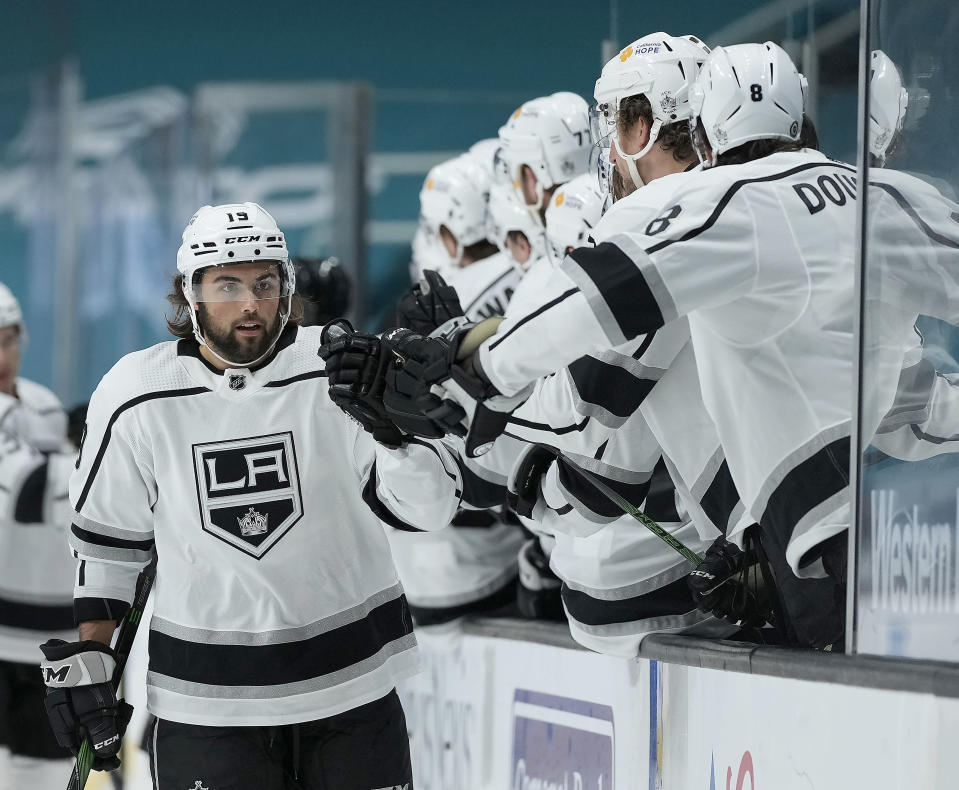 Los Angeles Kings right wing Alex Iafallo (19) is congratulated by teammates after scoring a goal against the San Jose Sharks during the first period of an NHL hockey game Friday, April 9, 2021, in San Jose, Calif. (AP Photo/Tony Avelar)
