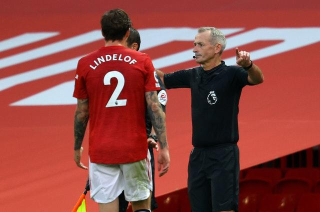 Referee Martin Atkinson awarded a controversial penalty for a Victor Lindelof handball at Old Trafford