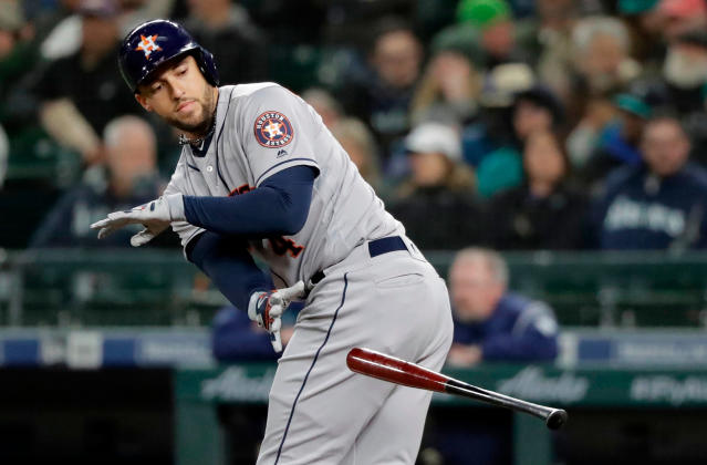 FILE - In this April 16, 2018, file photo, Houston Astros' George Springer tosses his bat after drawing a walk during a baseball game against the Seattle Mariners in Seattle. Springer is using a bat made by Axe Bat, a company headquartered in Renton, Wash., that is trying to revolutionize baseball with a simple concept -- a bat handle that is shaped like the handle of an axe. (AP Photo/Ted S. Warren, file)