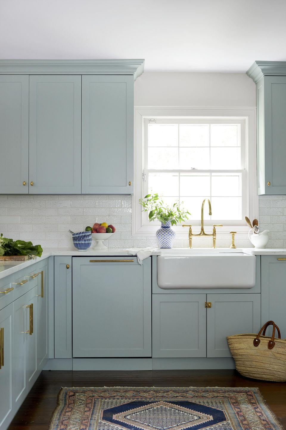 """<p>It's hard to deny the timeless appeal of classic, Shaker-style cabinetry. Simple in its construction yet refined in its precision, a Shaker cabinet works with a wide array of achitectural and decorative styles. <em>Today</em> cohost Jenna Bush Hager overhauled the midcentury kitchen in her <a href=""""https://www.veranda.com/home-decorators/a29416525/jenna-bush-hager-home-tour/"""" rel=""""nofollow noopener"""" target=""""_blank"""" data-ylk=""""slk:spirited Long Island cottage"""" class=""""link rapid-noclick-resp"""">spirited Long Island cottage</a> with pastel blue cabinetry (<a href=""""https://www.benjaminmoore.com/en-us/color-overview/find-your-color/color/hc-146/wedgewood-gray?color=HC-146"""" rel=""""nofollow noopener"""" target=""""_blank"""" data-ylk=""""slk:Wedgewood Gray by Benjamin Moore"""" class=""""link rapid-noclick-resp"""">Wedgewood Gray by Benjamin Moore</a>) that pops against a fireclay apron-front sink (<a href=""""https://www.rohlhome.com/"""" rel=""""nofollow noopener"""" target=""""_blank"""" data-ylk=""""slk:Rohl"""" class=""""link rapid-noclick-resp"""">Rohl</a>) and glazed wall tiles (<a href=""""https://www.waterworks.com/us_en/"""" rel=""""nofollow noopener"""" target=""""_blank"""" data-ylk=""""slk:Waterworks"""" class=""""link rapid-noclick-resp"""">Waterworks</a>). </p>"""