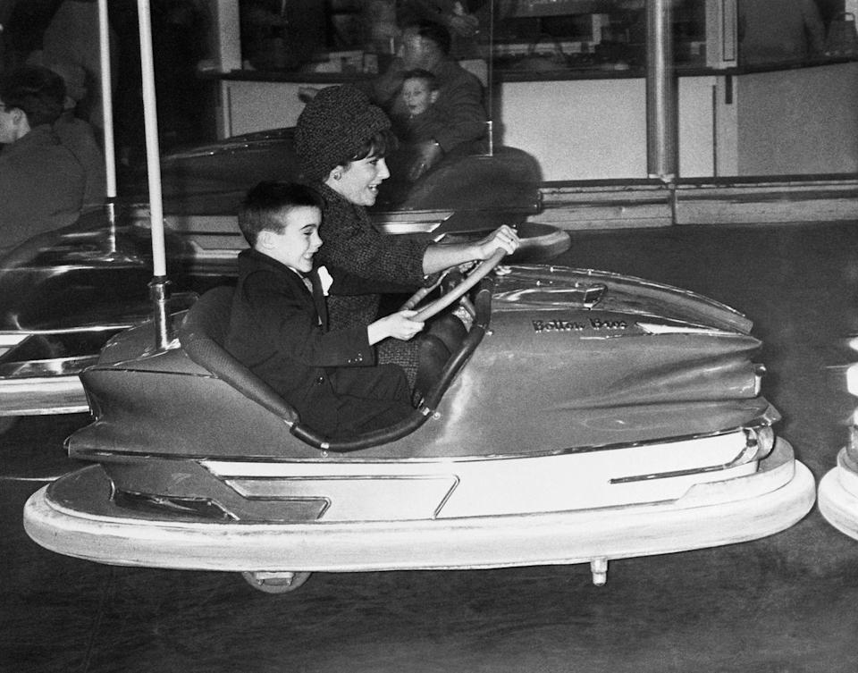 <p>Elizabeth and her son Michael are seen playing bumper cars at the circus in 1961. </p>
