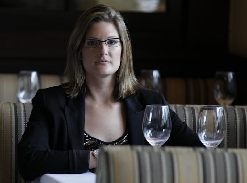 In this photo taken Thursday, March 22, 2012, Marisa Hannum, an assistant restaurant manager is seen at work in Reston, Va. As a married woman, Hannum had her family's conservatism on her mind when she backed Republicans in the two most recent presidential elections. Now divorced, Hannum is putting her own interests first as she weighs whether to back President Barack Obama or his Republican challenger. Unmarried women are emerging as a critical constituency in an election year focusing heavily on social issues and the economy. Democrats are trying to energize them while Republicans work to peel them away. (AP Photo/Carolyn Kaster)