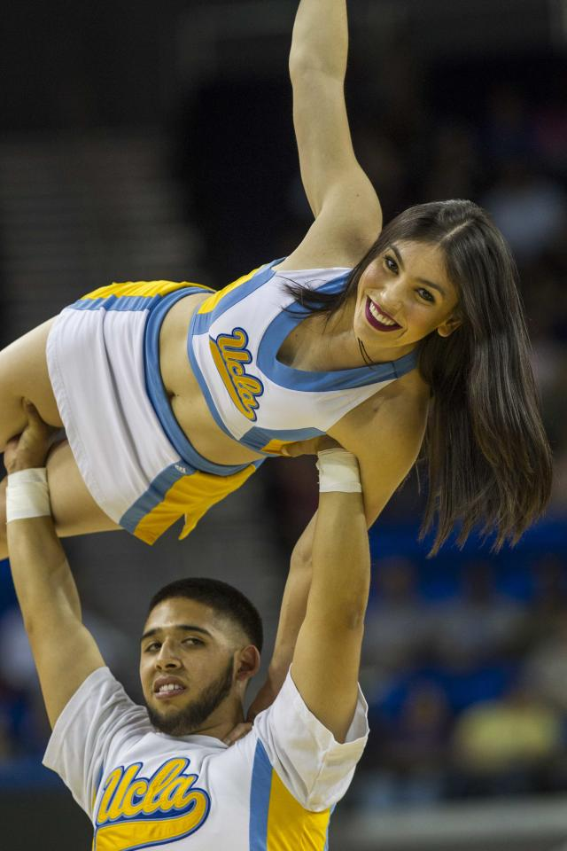 UCLA cheerleaders perform in the second half of an NCAA women's college basketball game, Sunday, Feb. 23, 2014 in Los Angeles. (AP Photo/Ringo H.W. Chiu)