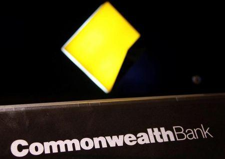 The logo of Australia's Commonwealth Bank adorns an automatic teller machine (ATM) in central Sydney, Australia