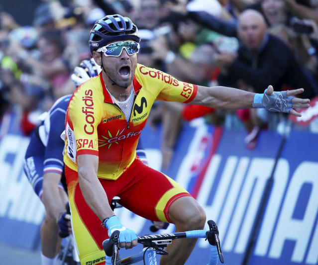 Spain's Alejandro Valverde crosses the finish line to win the men's road race at the Road Cycling World Championships in Innsbruck, Austria, Sunday, Sept.30, 2018. (AP Photo/Alessandro Trovati)