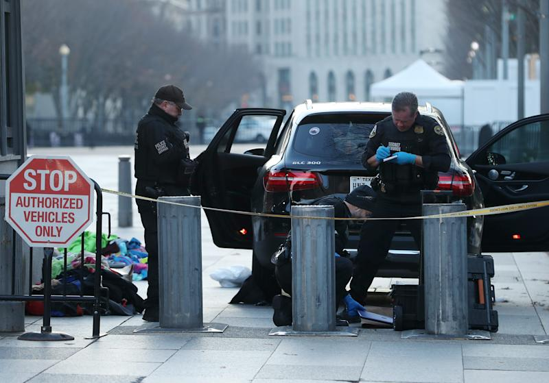 Members of the U.S. Secret Service examine belongings removed from a vehicle that tried to drive into a restricted area near the White House, on Nov. 21, 2019 in Washington.