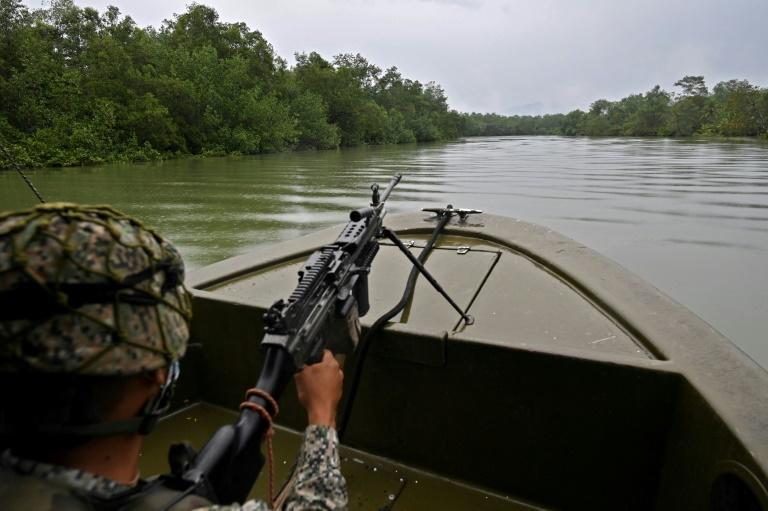 The mangrove on the estuary in Buenaventura is a dangerous place for the locals who believe many dead people have been dumped there